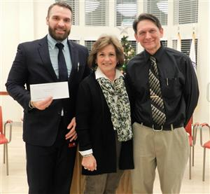 MPS staff  accept grant awards from Brigham Family Trust