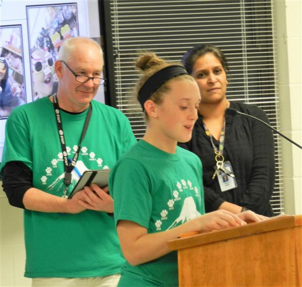 Abigail Hennessy, grade 7 student, presents to School Committee
