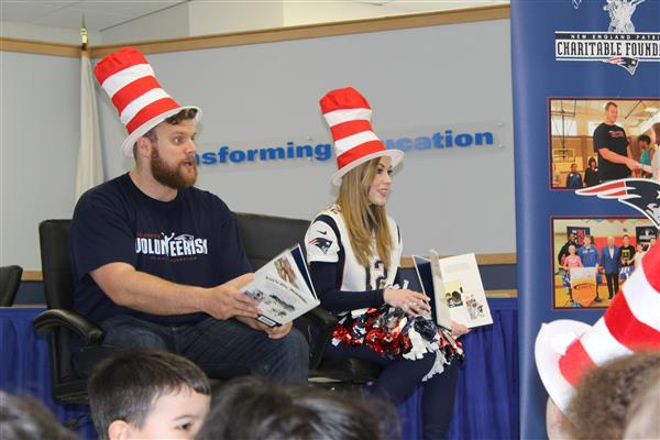 Patriots player reading to ECC students