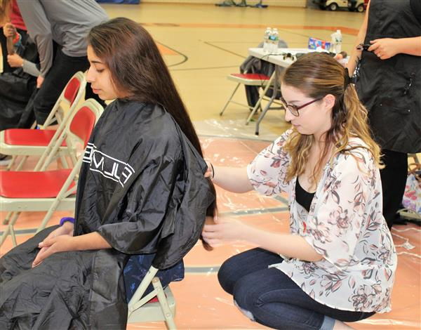 MHS students and teachers donate hair to help children with cancer