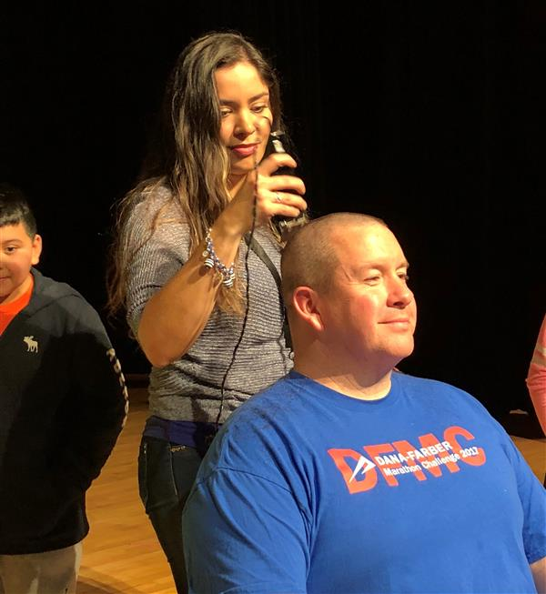 Rick Lacina gets head shaved for cancer research