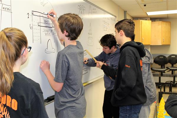 Robotics Club Members Work on Design